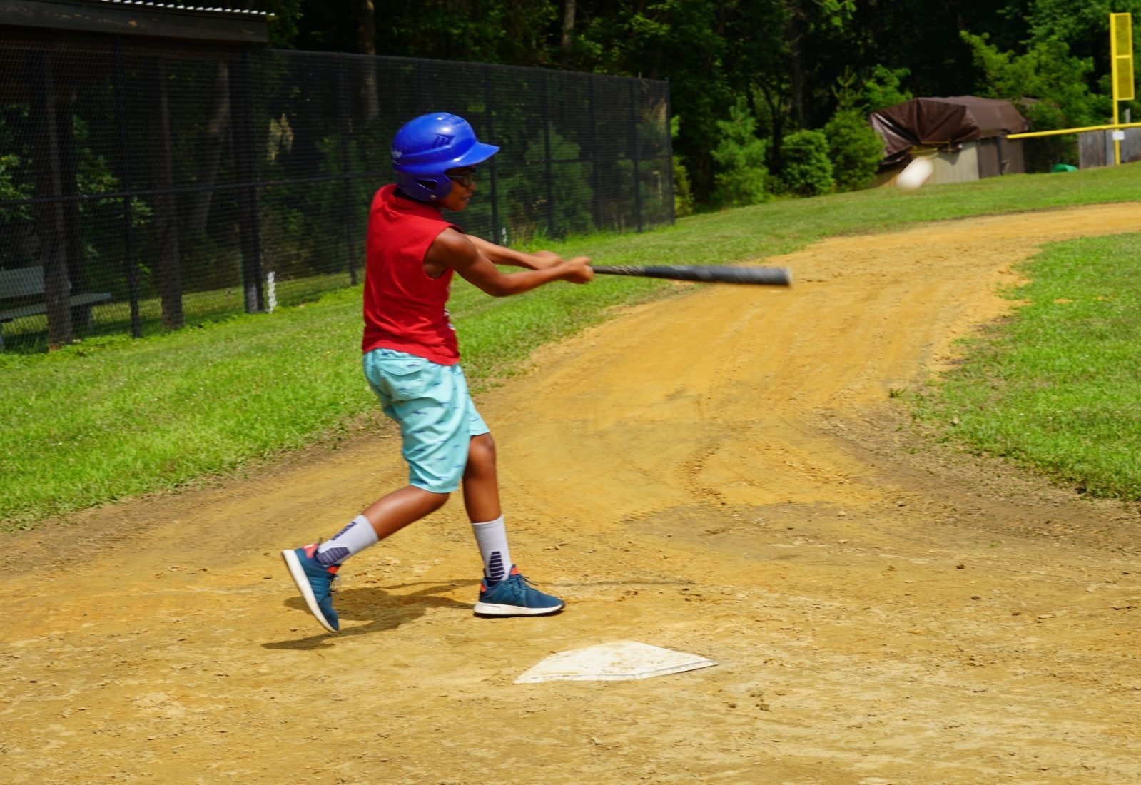 A young boy swinging a bat
