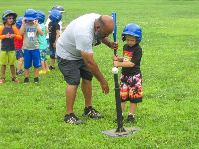 Camper at a baseball clinic