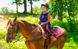 Girl horseback riding and smiling