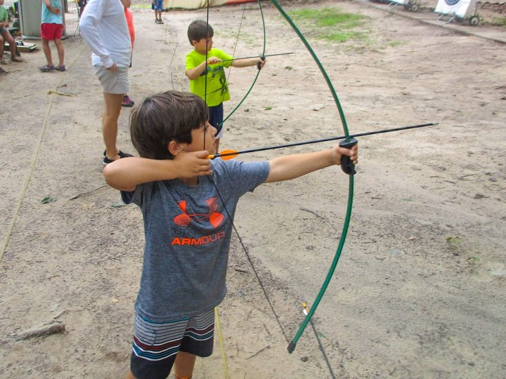 Boys playing archery