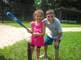 Boy and girl playing t-ball
