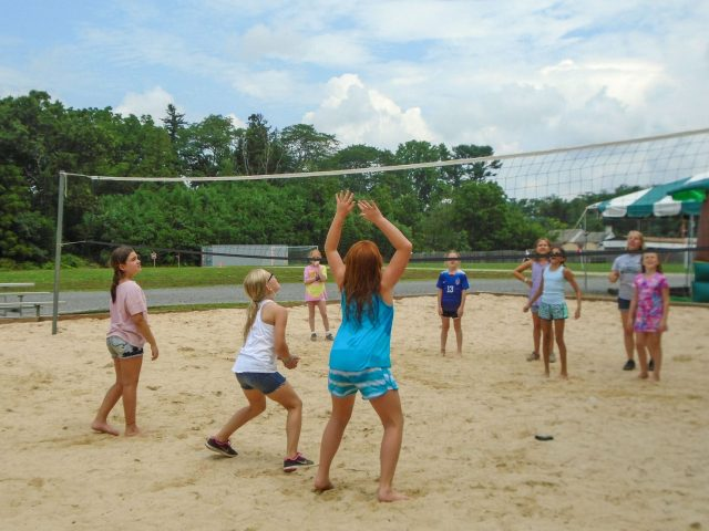 Campers playing beach volleyball