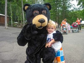 Black bear mascot with camper