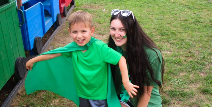 a counselor and kid in green