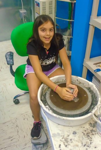 Girl on pottery wheel