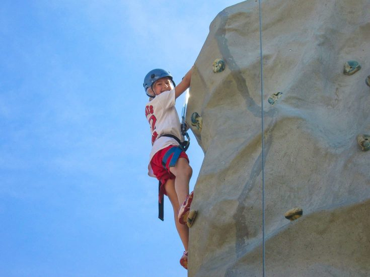 Girl climbing rockwall