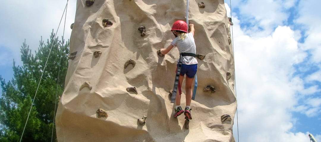 Camper on climbing tower