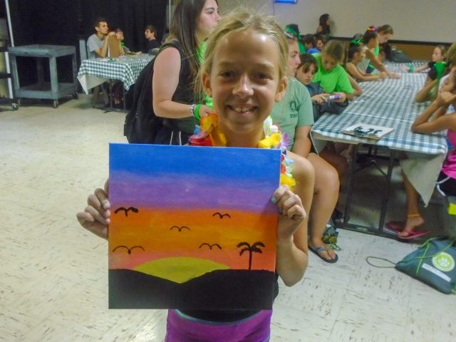 Girl holding a painting she made