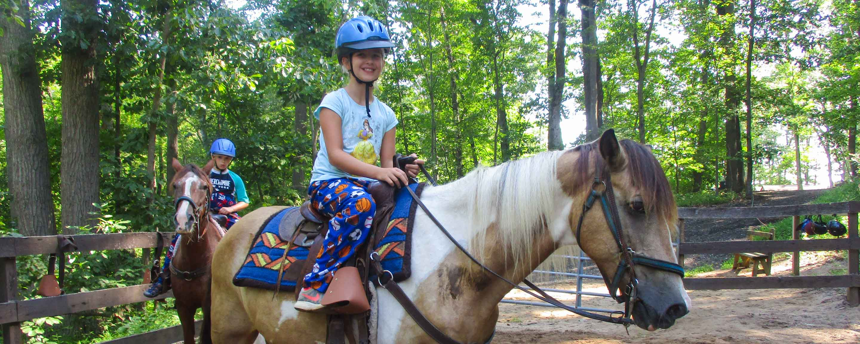 Campers horseback riding