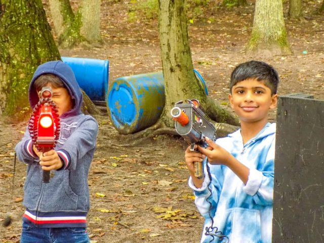 Two campers playing laser tag