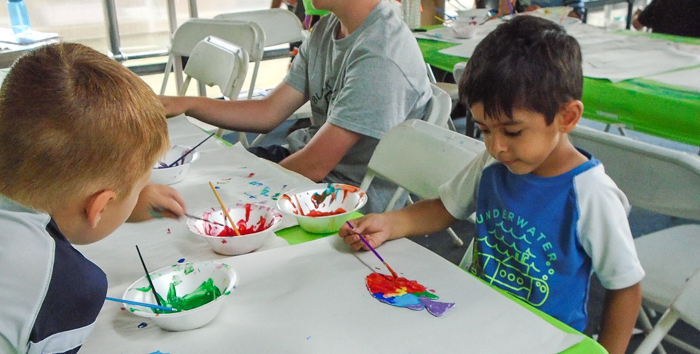 Two boys painting
