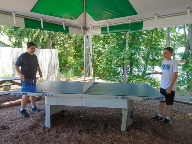 Two campers playing ping pong