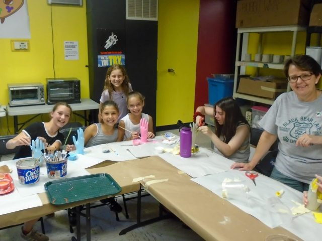 Campers at pottery