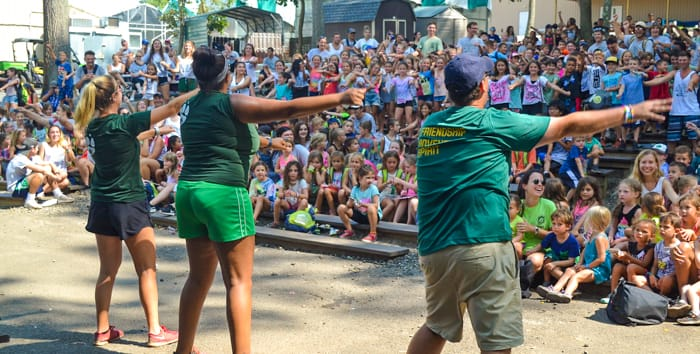 Staff dancing in front of campers