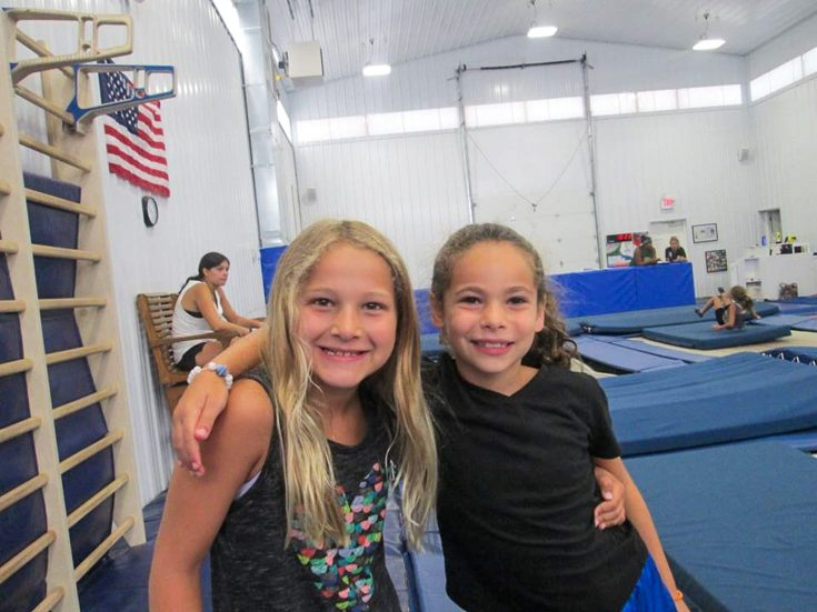 Girls by trampoline park