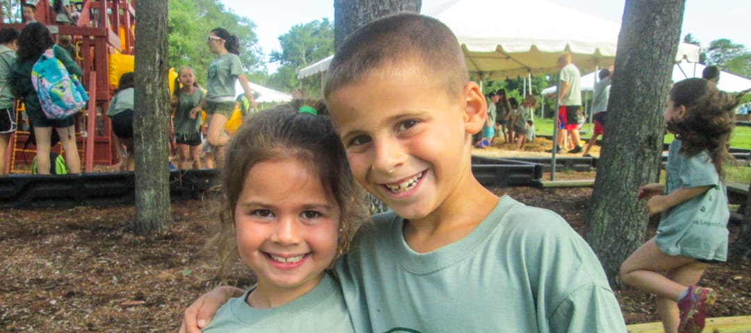 Two young campers smiling