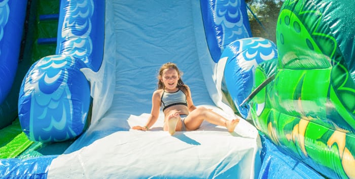 Girl sliding down giant waterslide